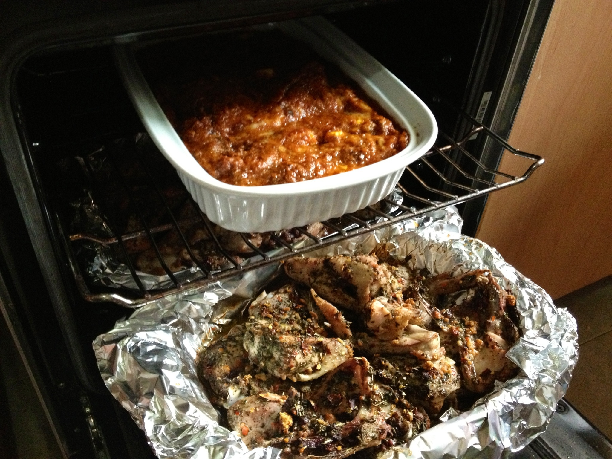 Lasagna and herbed chicken in the oven
