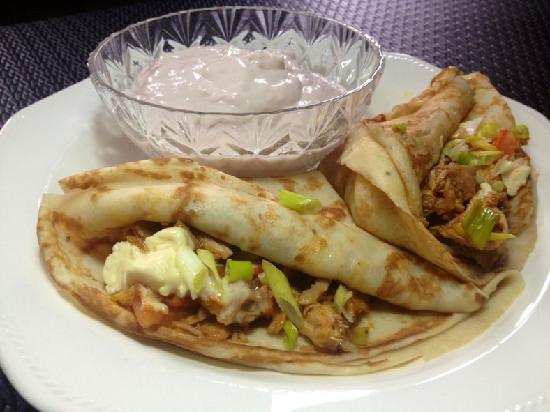 Savoury crepes and a side of yoghurt