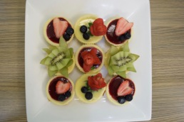 Mini cheese cakes on square plate aerial view
