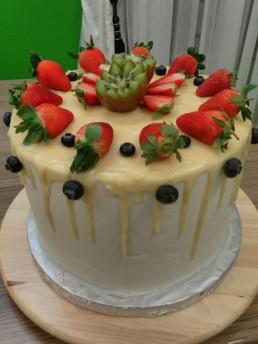 white drip cake full view